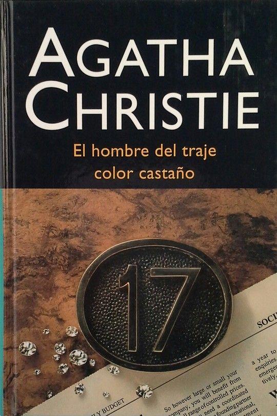 EL HOMBRE DEL TRAJE COLOR CASTAÑO